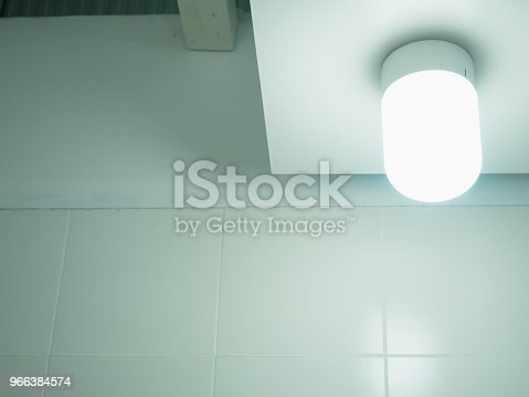 940992564 istock photo interior and decorate concept from lighting with modern lamp decorate on wall with soft focus background 966384574