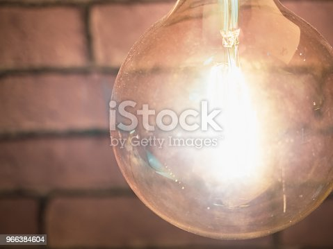 940992564 istock photo interior and decorate concept from lighting with modern lamp decorate on wall with soft focus background 966384604