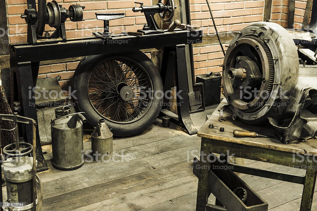 Interior and equipment of an old garage, auto repair shop royalty-free stock photo