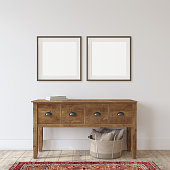 Farmhouse entryway. Wooden console table near white wall. Frame mockup. Two black square frames on the wall. 3d render.