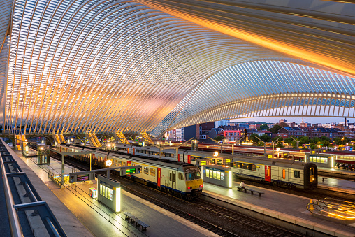 Liège, Belgium - September 13, 2020: Interior and Platforms of Liège-Guillemins railway station, the main station of the city of Liège, the third largest city in Belgium. It is one of the most important hubs in the country and is one of 3 Belgian stations on the high-speed rail network. The station, which cost €312 mln to build, was designed by architect Santiago Calatrava and officially opened on 18 September 2009.
