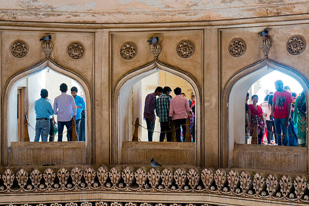 Interior arches charminar hyderabad Hyderabad, Telangana, India, 28th Feb 2016: Interior arches of the second floor in the charminar Hyderabad showing people visiting char minar stock pictures, royalty-free photos & images