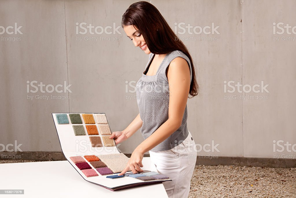 Interior Architect Choosing Rug Sample stock photo