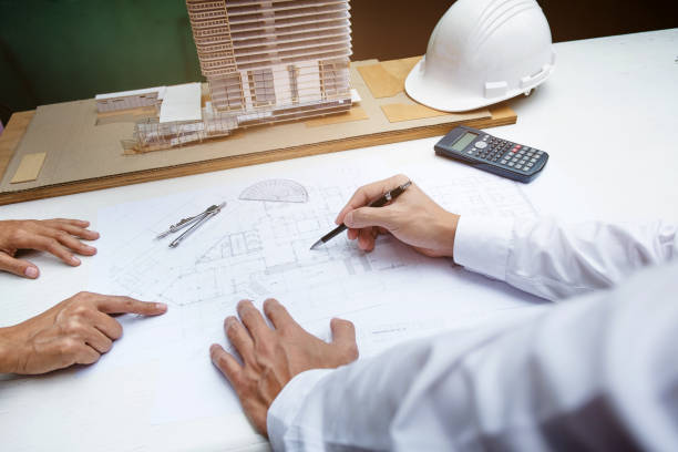 interior architecture working on building plan project stock photo