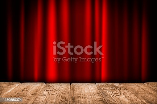 Interior background - empty wooden table and red curtain