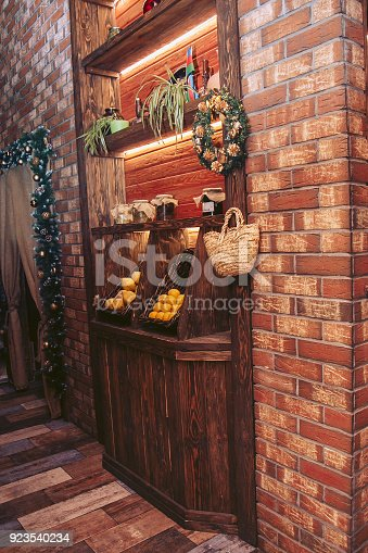 914465180 istock photo Interior cafe. Wooden niche with shelves and baskets for food 923540234