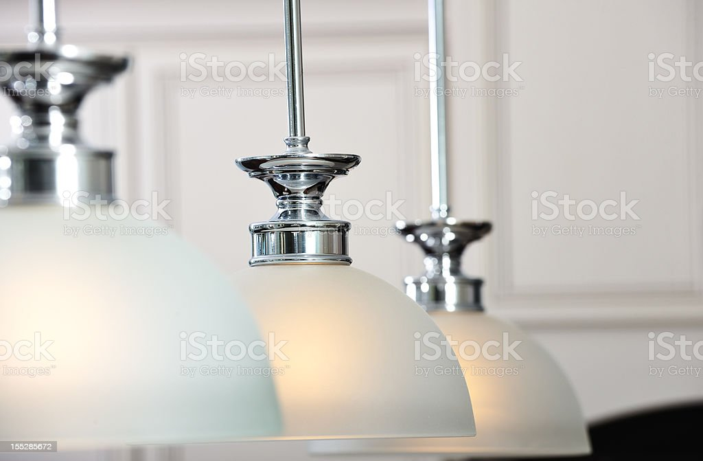 Interior ceiling lightings with white semi-spherical covers stock photo