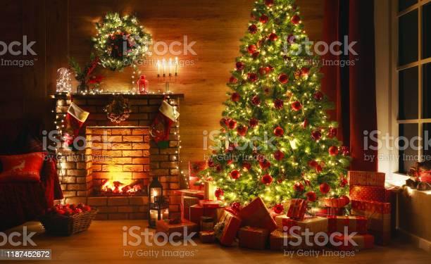 Interior christmas magic glowing tree fireplace gifts in dark picture id1187452672?b=1&k=6&m=1187452672&s=612x612&h=wa6l3xvvnvylhpfkm9rxawl7c7knt60iwufsqik7jcq=