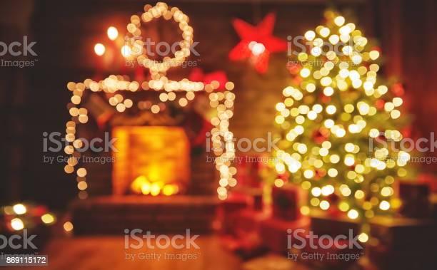 Interior christmas magic glowing tree fireplace gifts in dark picture id869115172?b=1&k=6&m=869115172&s=612x612&h=14vs3idrfwaax xkm7vdt4ybjyoqw9bimgj pjxgyk8=