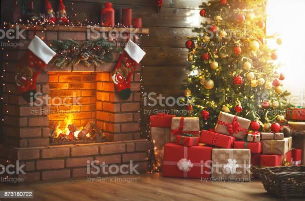 Interior christmas magic glowing tree fireplace gifts picture id873180722?b=1&k=6&m=873180722&s=612x612&h=ytuvmlovjjusnfrzq4xpeb y tlgyuqtj nmzmbdcrm=