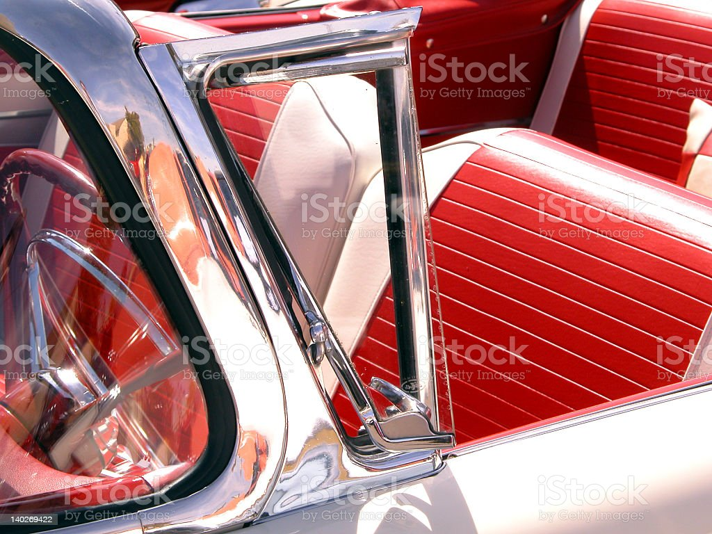 Interior close-up of vintage car with chrome and red leather royalty-free stock photo