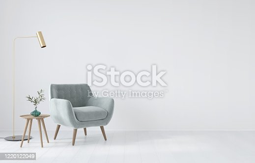 Interior composition with a soft armchair, a table and a golden lamp on a white wall background / 3D illustration, 3d render