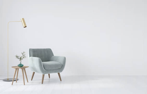 Interior composition with a soft armchair, a table and a golden lamp Interior composition with a soft armchair, a table and a golden lamp on a white wall background / 3D illustration, 3d render armchair stock pictures, royalty-free photos & images