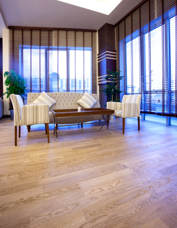 Hardwood brown floor background. Indoor laminate decoration image. Interior decoration.