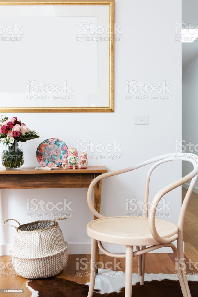 Interior decoration styled with chair and side table and blank wall frame stock photo