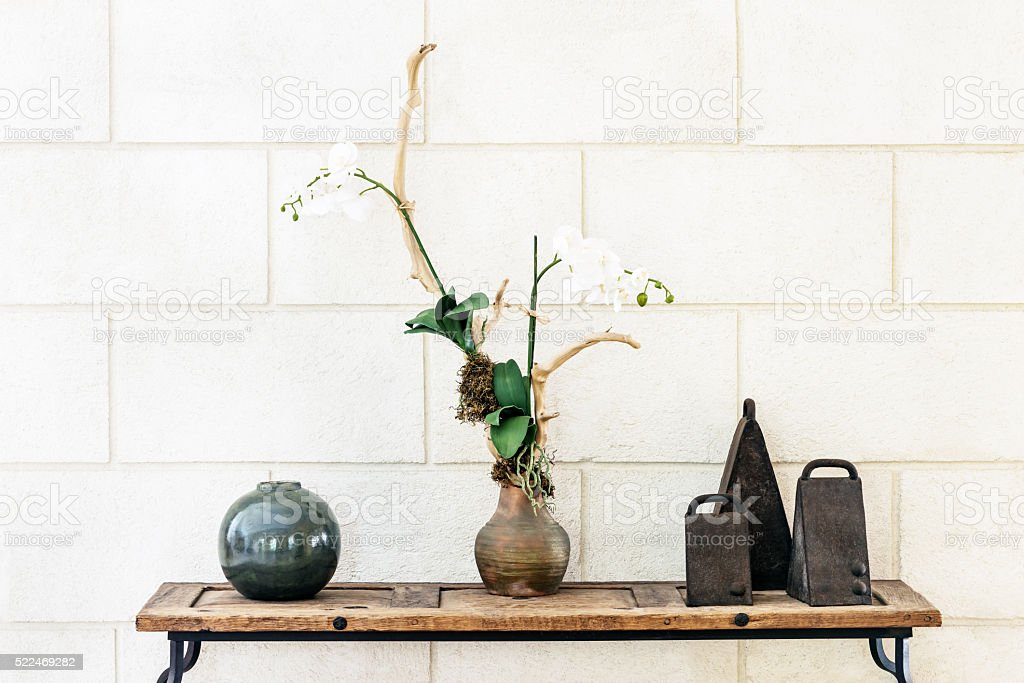 Interior decorative arrangement ornament with orchid bells and ceramic ball stock photo