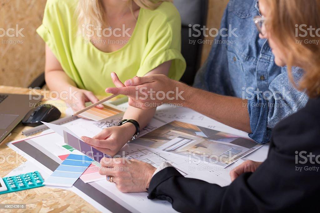 Interior decorator choosing color stock photo
