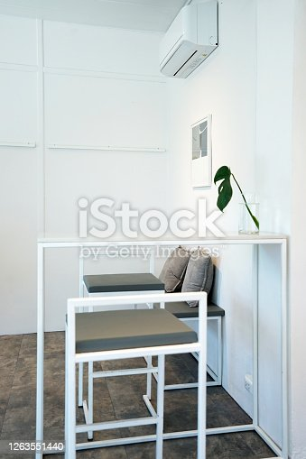 istock Interior design and decoration of coffee bar and bakery pastry shop mostly decorated with white wall and loft furniture 1263551440