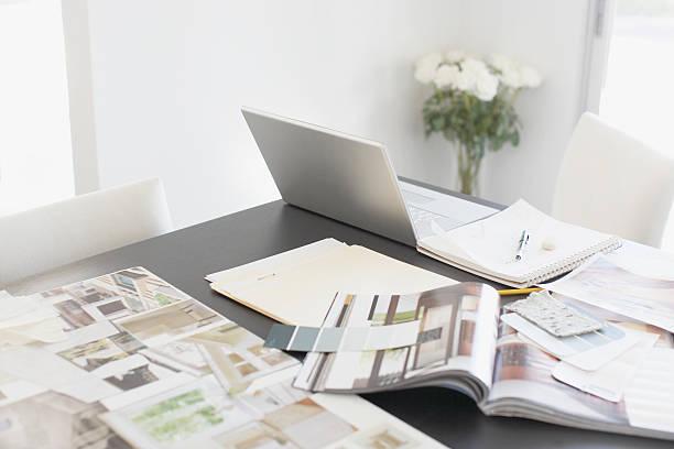 interior design books on table - interior design stockfoto's en -beelden