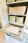 Showcase interior design of a utility laundry room in a residential home in United States. Detail storage unit and built-in clothes drying rack.
