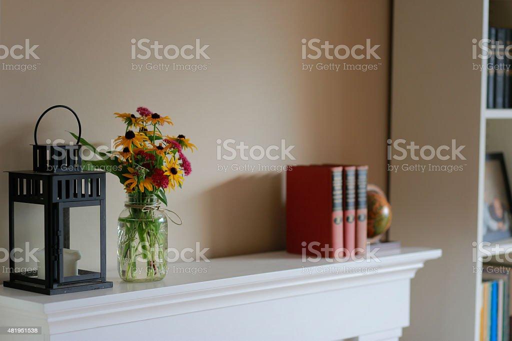 Interior Design Flowers on Mantle stock photo