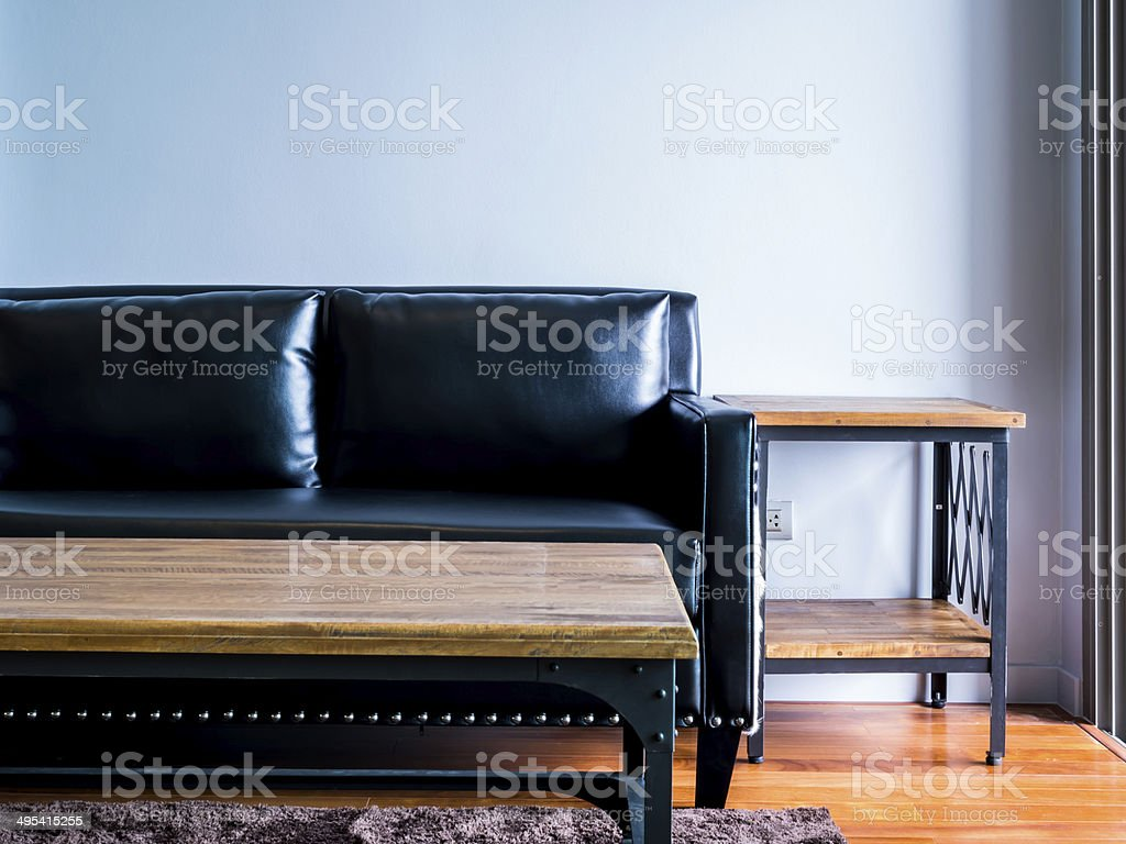 Interior design of empty moderm room with black couch stock photo