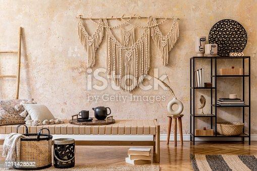 Interior design of boho living room. Oriental concept of home decor. Wabi sabi.