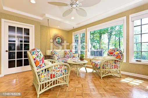 Showcase interior design of a solarium or a sun room in a residential home in United States.