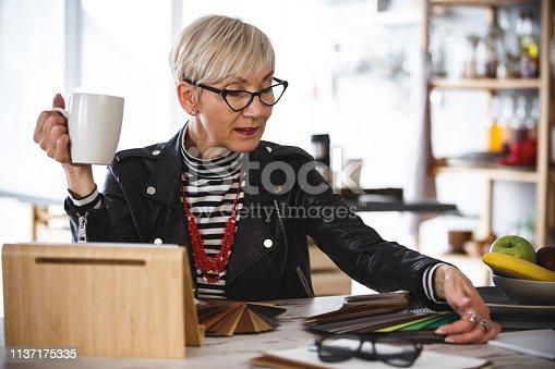 Interior designer choosing a baseboard.
