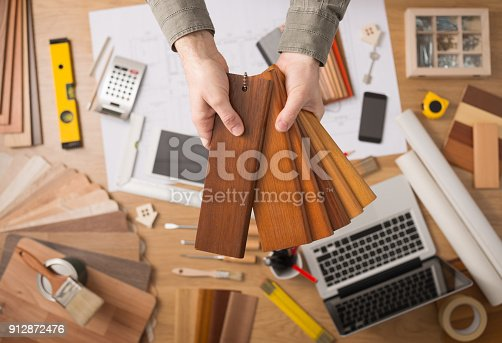 istock Interior designer choosing a baseboard 912872476