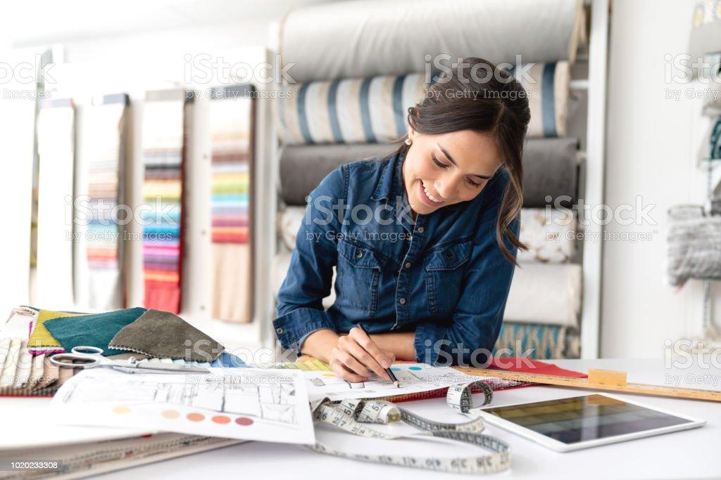 Interior Designer Choosing Fabrics At A Textile Shop Stock Photo Download Image Now Istock