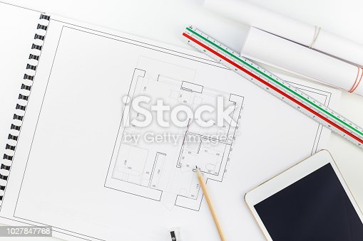 1174841541 istock photo Interior designer table workplace with house plan 1027847768