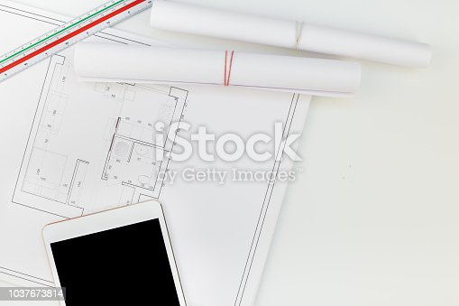 1174841541 istock photo Interior designer table workplace with house plan 1037673814