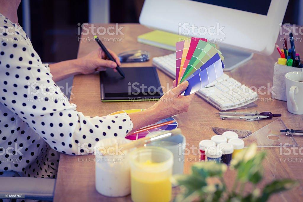Interior designer working at desk stock photo