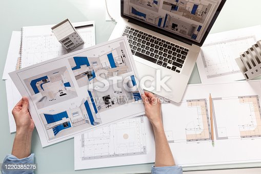 Interior designer working with a kitchen visual renderings in a design bureau. Architectural desigh bureau working concept