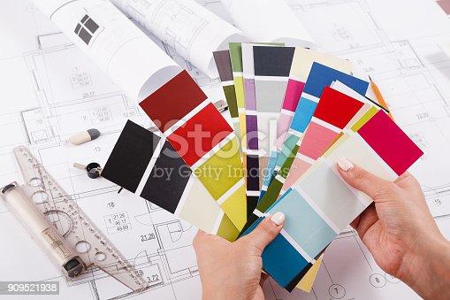 istock Interior designer working with palette closeup 909521938