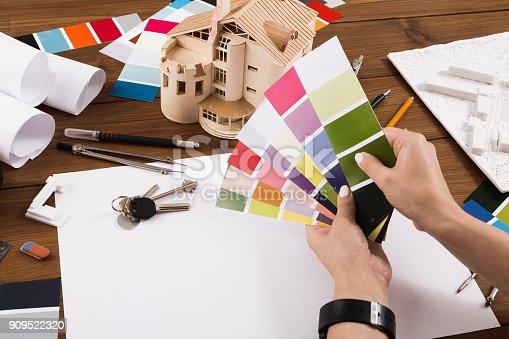istock Interior designer working with palette closeup 909522320