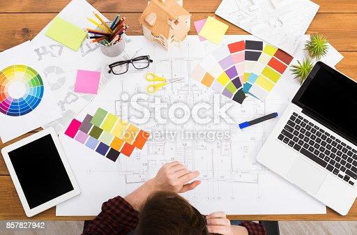 istock Interior designer working with palette top view 857827942