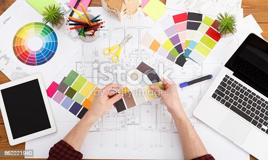 istock Interior designer working with palette top view 862221940