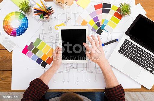 istock Interior designer working with palette top view 863541552