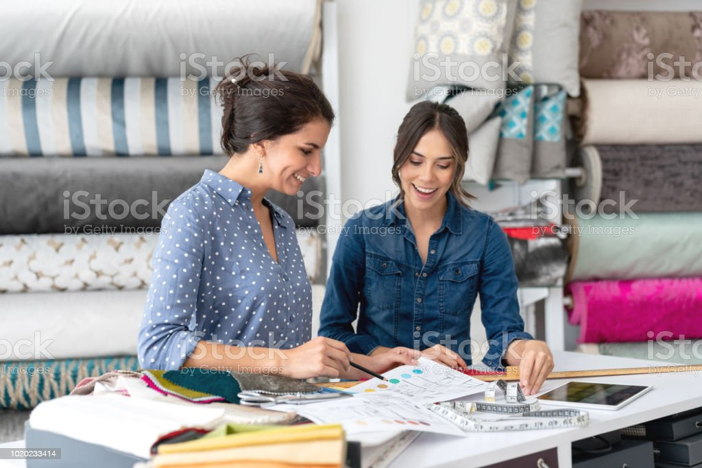 Interior Designers Choosing Fabrics At A Textile Shop And Talking To Saleswoman Stock Photo Download Image Now Istock