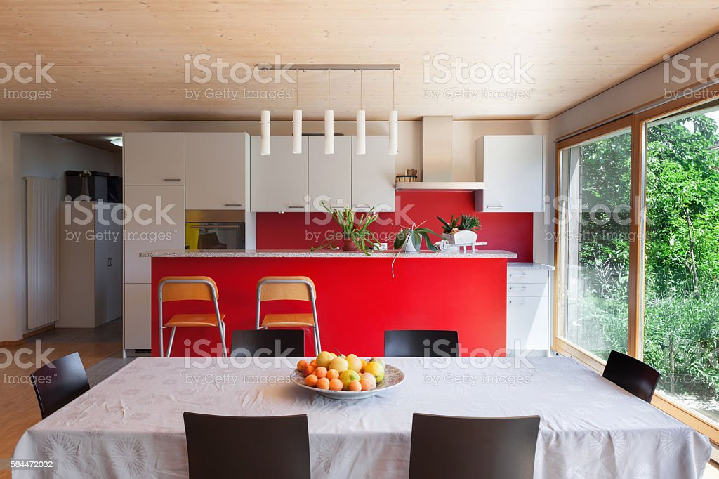 Interior, dining table and kitchen Interior of an eco house, dining table and kitchen Architecture Stock Photo