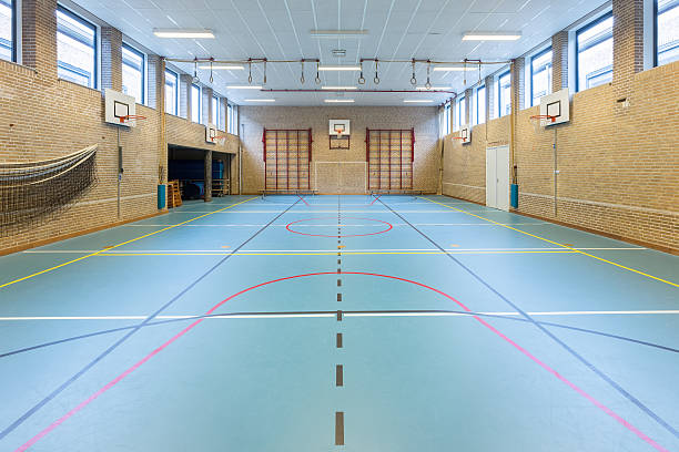 interior dutch gymnasium for school sports - volleyball sport stock photos and pictures
