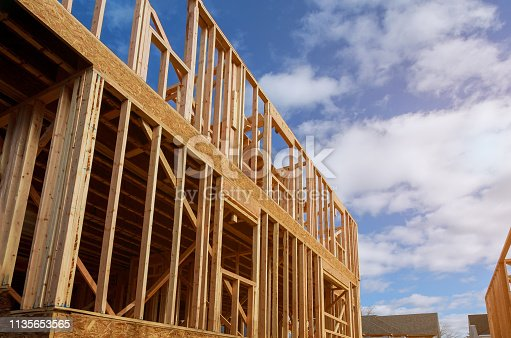 istock Interior framing beam of new house under construction home framing 1135653565