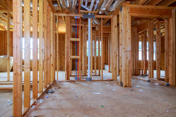 Interior framing of a new house under construction Interior framing of a new house under construction construction home framing studded stock pictures, royalty-free photos & images