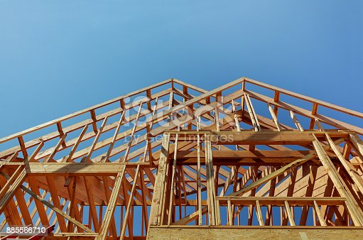 istock Interior framing of a new house under construction 885566710