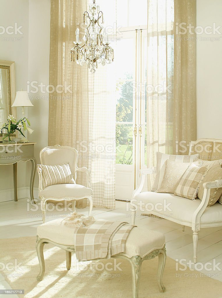 Interior French two seater sofa and chair in living room royalty-free stock photo