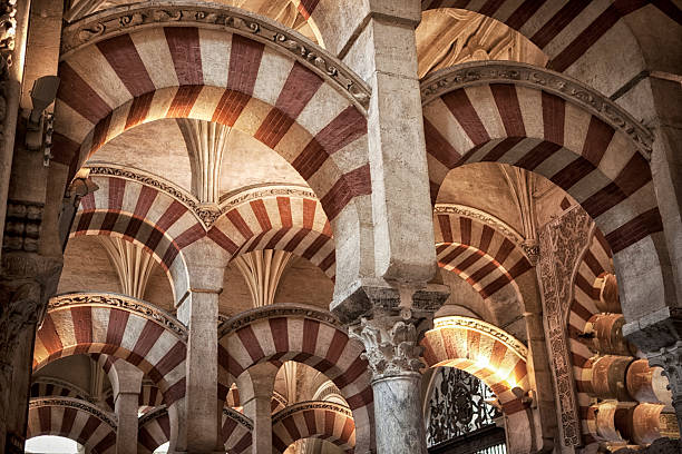 Interior from famous Mesquita mosque in Cordoba. Detail from interior of the famous mosque - La Mesquita in Cordoba. cordoba mosque stock pictures, royalty-free photos & images