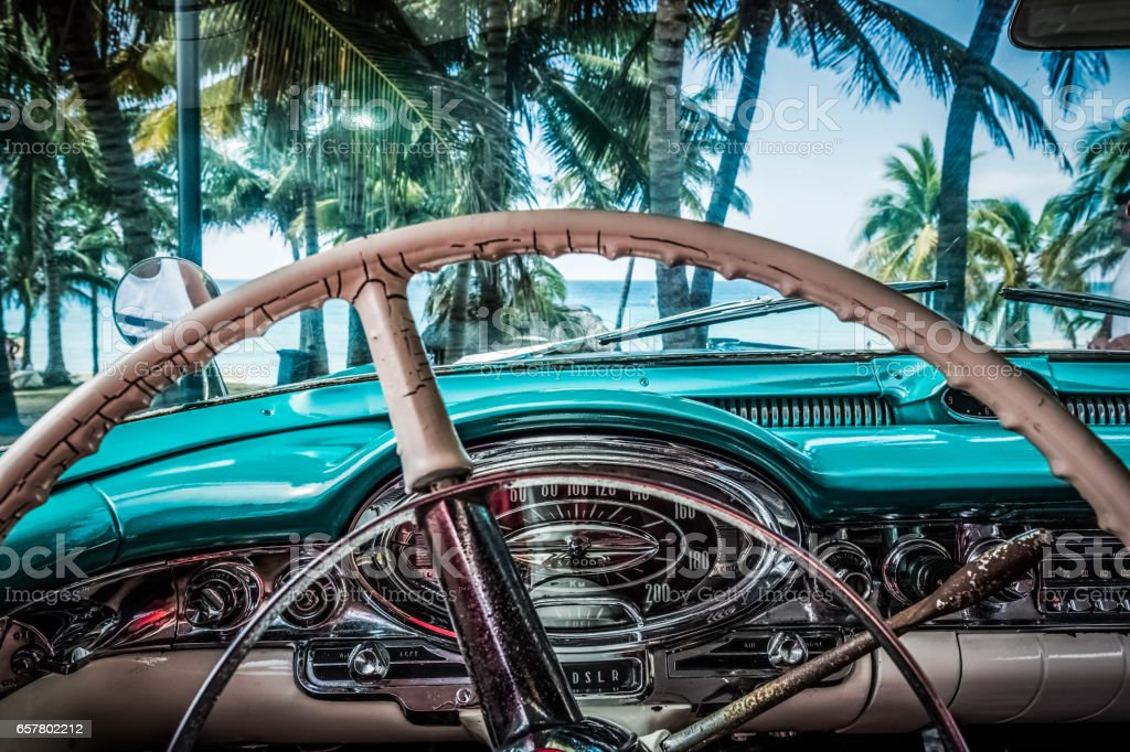 Interior from vintage car on the beach in Varardero Cuba stock photo