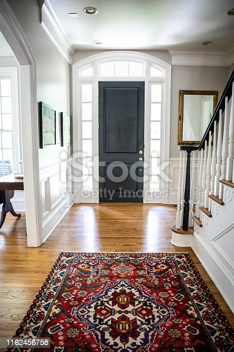 Interior front door hall hallway entrance to Home with Vaulted Ceilings